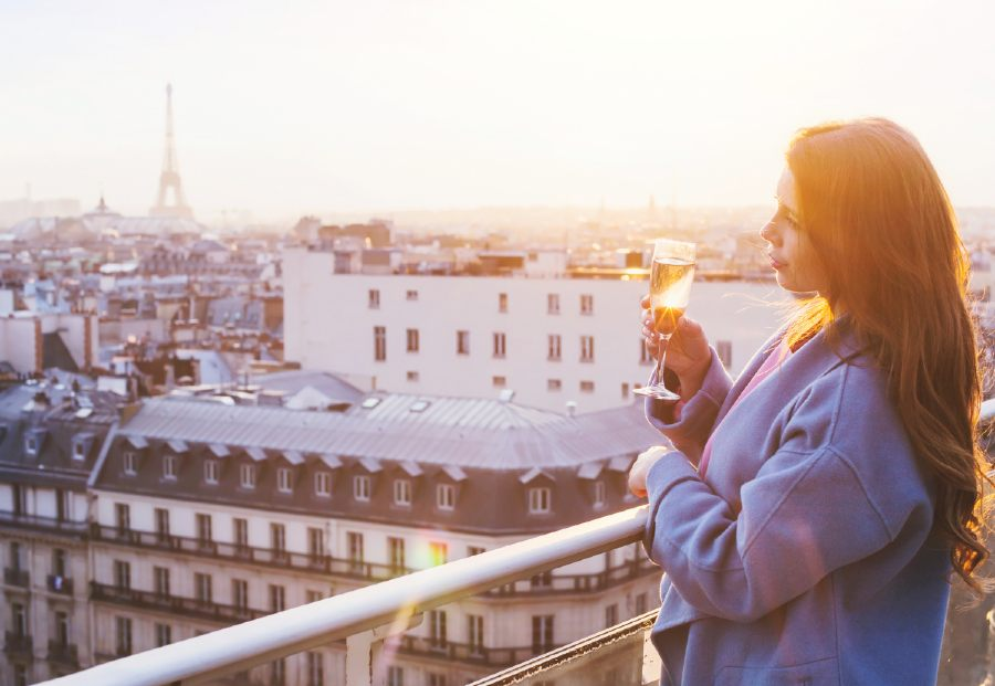 Having Cocktails with a view at a rooftop bar is one of the romantic things to do in Paris