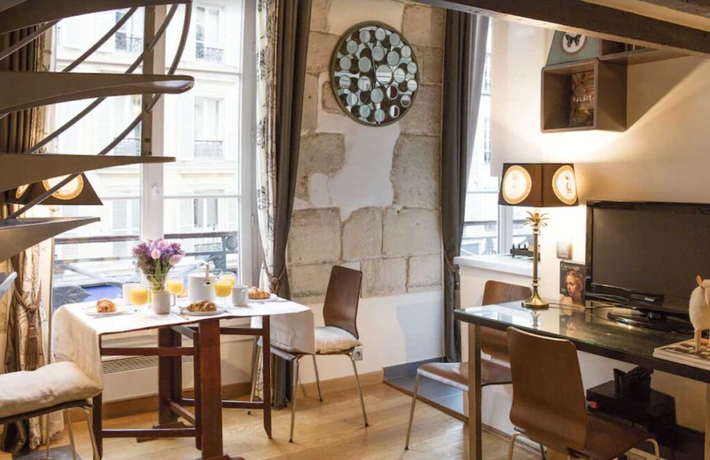 This Large duplex studio at the corner of the town hall square is one of the holiday apartments Paris