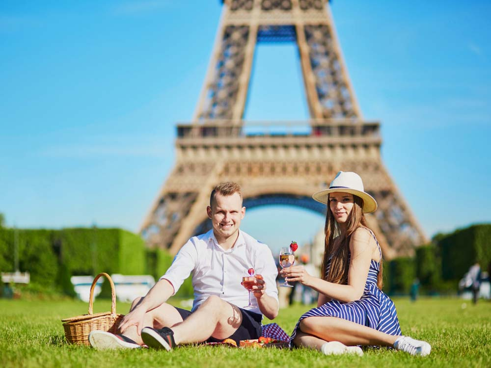 Picnicking under the Eiffel tower is one of the most romantic things to do in Paris